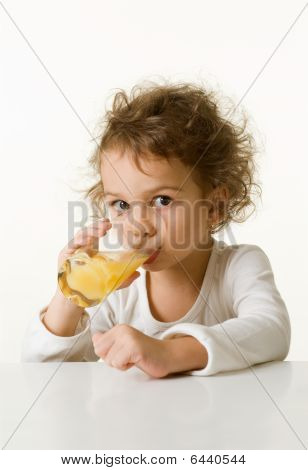 Little Girl Drinking Orange Juice