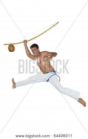 Capoeira, Brazilian Man jumping, berimbau