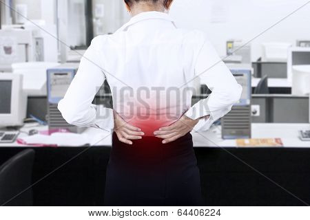 Businesswoman Having Back Pain At Office