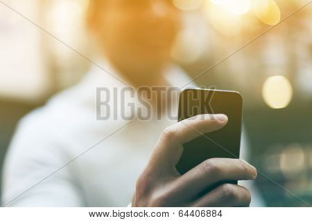 Smartphone In Hand Of Business Man