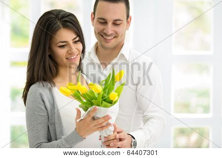 Amorous couple together with beautiful  bouquet of tulips