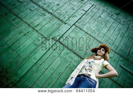 Woman in front of fence