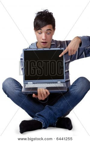 Young Male Teenager Pointing Excited At Computer  Laptop Display
