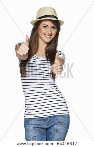 Happy excited young woman gesturing thumbs up