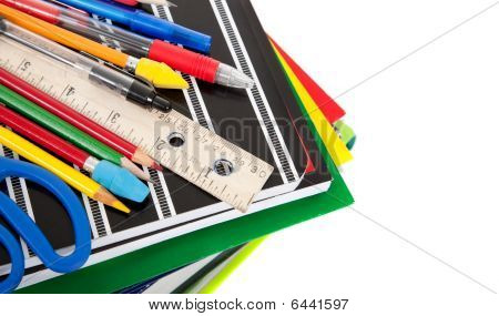 School Supplies On White With Copy Space