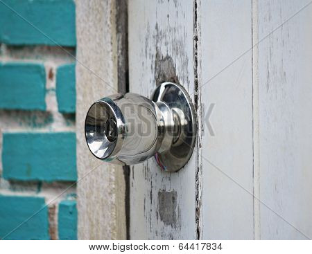 Door knob on white door