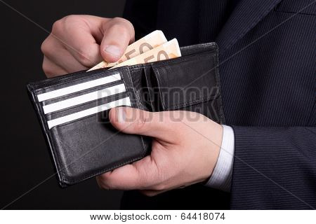 Leather Purse With Euro Banknotes In Business Man Hands
