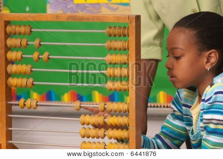 African-american Child Using A Abacus