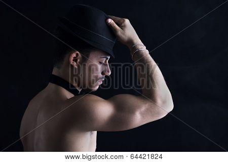 Profile Of Shirtless Young Latino Man With Black Fedora Hat
