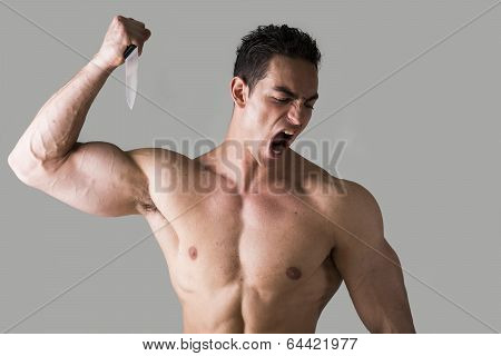 Muscular Young Man Holding Big Knife Ready