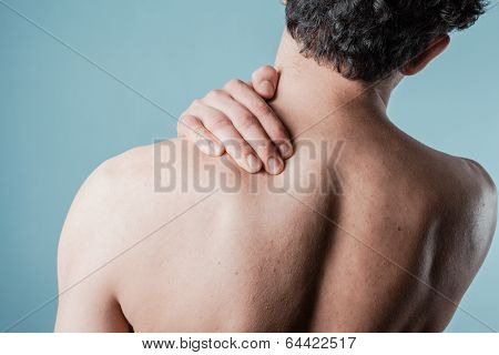 Young Man Massaging His Sore Neck