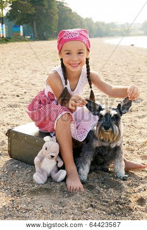 Little Girl And Her Dog Sitting On The Bank