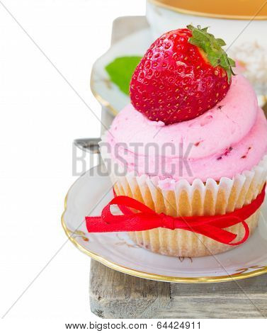 cupcake with strawberry on white