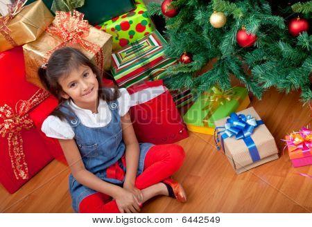 Girl Next To A Christmas Tree