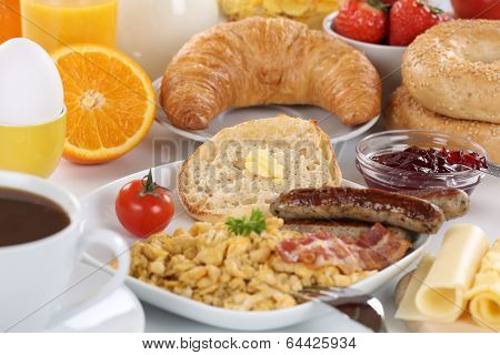 Breakfast With Orange Juice, Marmalade, Coffee, Bagels, Fruits And Scrambled Eggs