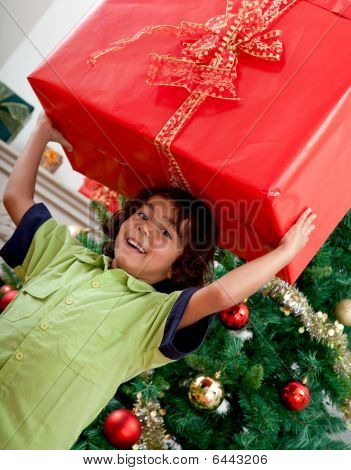Boy Carrying A Christmas Present