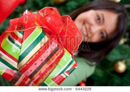 Woman Giving A Christmas Gift