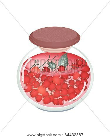 A Jar Of Delicious Preserved Red Cherries