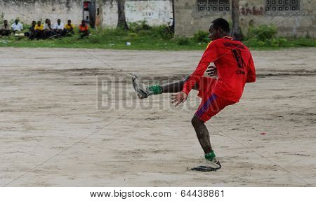 ZANZIBAR, TANZANIA - MARCH 26 2013: local african soccer team during training on sand playing field