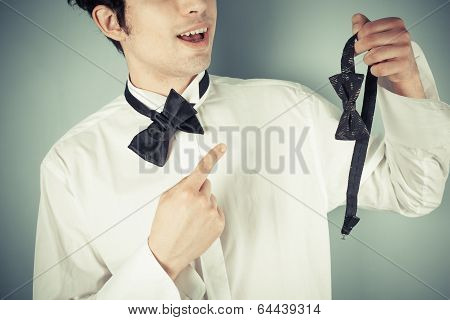 Man With Bow Tie And A Clip On