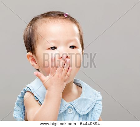 Little girl covered her mouth