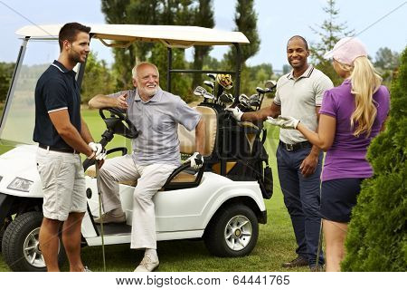 Happy companionship ready for golfing around golf cart.