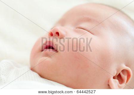 Little ewborn leeping baby