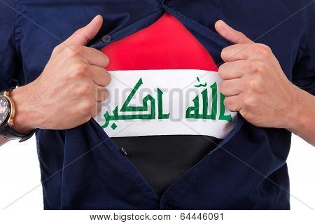 Young Sport Fan Opening His Shirt And Showing The Flag His Country Iraq, Iraqi Flag