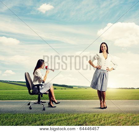 displeased woman and calm smiley woman at outdoor