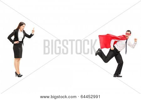 Superhero running away from an angry businesswoman isolated on white background