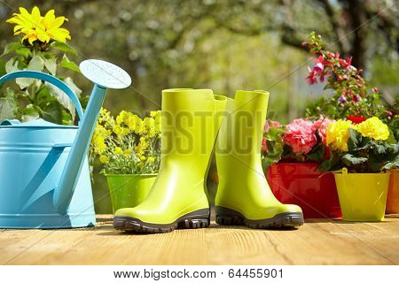 Outdoor gardening tools and flowers on old wood table