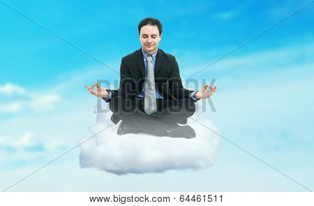 Businessman sitting on a cloud