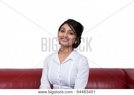 Smiling businesswoman sitting on sofa