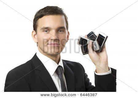 Young Businessman With Many Phones