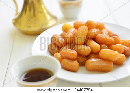 Close up of a middle eastern sweet with traditional coffee
