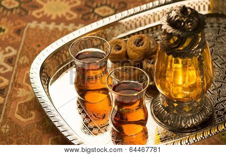 Arabic lantern, sweet and tea still life