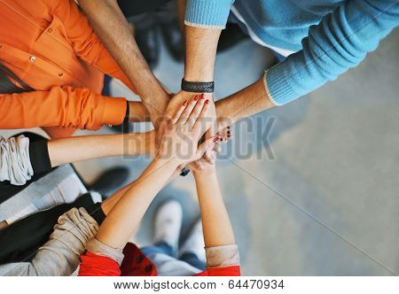 Group Of Young People Stacking Their Hands