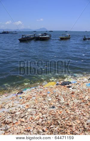 SEMPORNA, MALAYSIA - APRIL 24 2014: Plastic rubbish pollution in ocean. Photo showing pollution problem of garbage thrown directly into the sea with no proper trash collection or recycling.