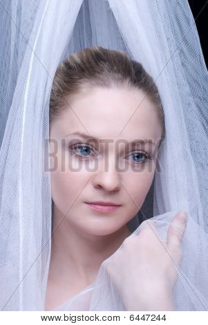 Closeup Portrait Of Beautiful Blond Girl In White Fabric