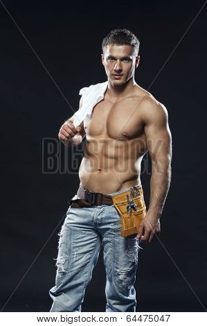 Image Of Young Handsome Builder Posing, On Dark Background