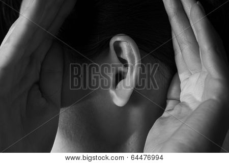 Woman Holds Her Hands Near Ear