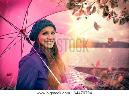 friendly girl laughing with pink umbrella