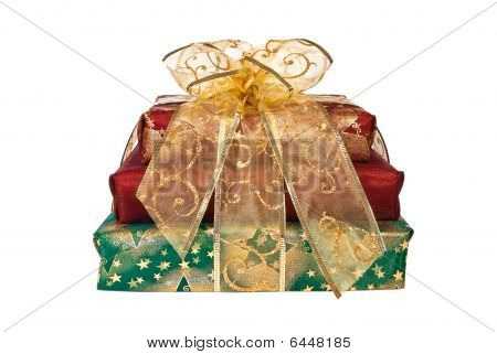 Stack Of Wrapped Gift Boxes With Gold Ribbon And Bow