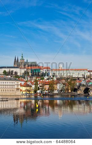 View of Charles bridge over Vltava river and Gradchany (Prague Castle) and St. Vitus Cathedral
