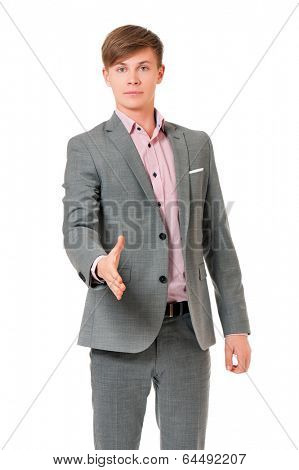 Successful young businessman greets with his hand, isolated on white background