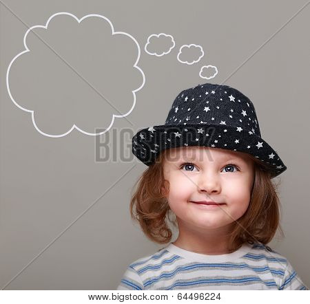 Dreaming Kid Girl In Hat Looking Up On Empty Bubble Above On Grey Background