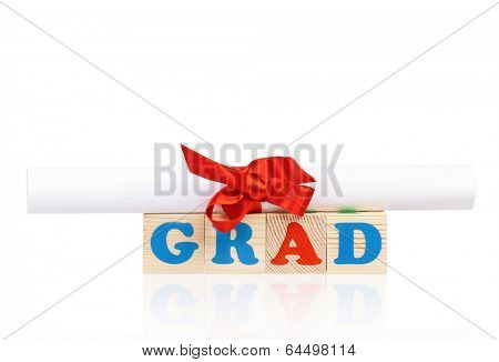 Grad words formed by wood alphabet blocks with diploma, isolated on white background