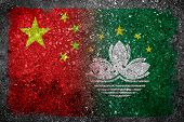 stock photo of merge  - Merged Flags of China and Macau painted on grunge concrete - JPG