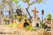 stock photo of playa del carmen  - Traditional torches on colorful Mexican graveyard near Playa del Carmen - JPG
