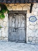 foto of hacienda  - Old locked colonial doors of mexican hacienda - JPG